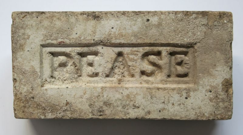 White brick in-printed with the word Pease