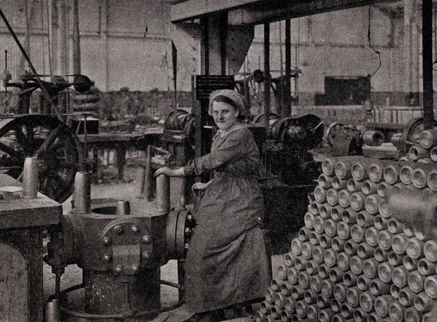 A woman poses with a shell cartage machine at North Road Locomotive works which was turned into a munitions factory in the first world war