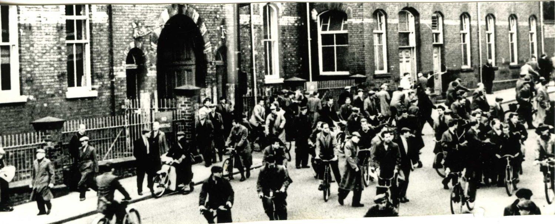 Photograph of men leaving work, North Road Station, Darlington