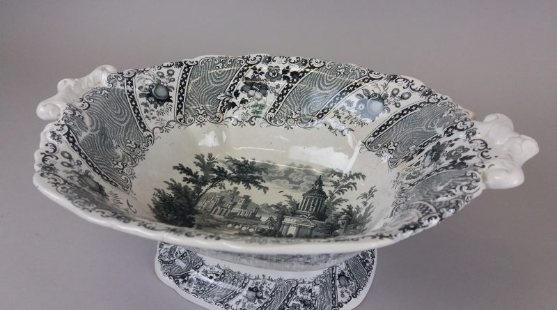 Oval shaped black and white dish with decorated base
