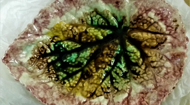 plate in the shape of a leaf imprinted with the veins of a leaf