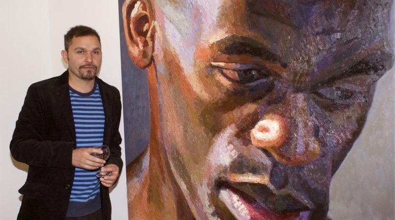 Nahem Shoa sanding alongside Giant Head Ben at Hartlepool Art Gallery