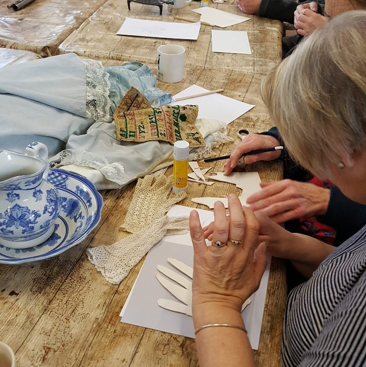 Members of the Socialites take part in a workshop at Preston Park Museum