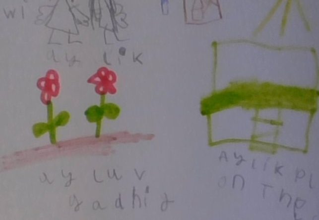Child's drawing of flowers and a house