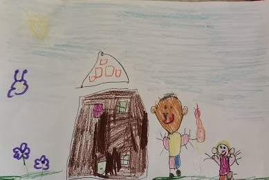 Children's drawing of a boy stood next to a house