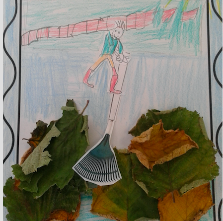 Childrens drawing of a boy raking leaves. Real leaves have been used at the bottom of the page.