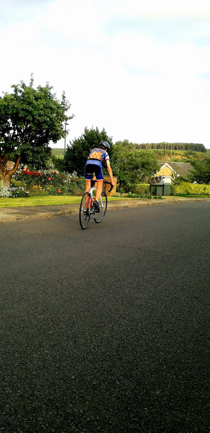 photograph of a man racing on a pedal bike