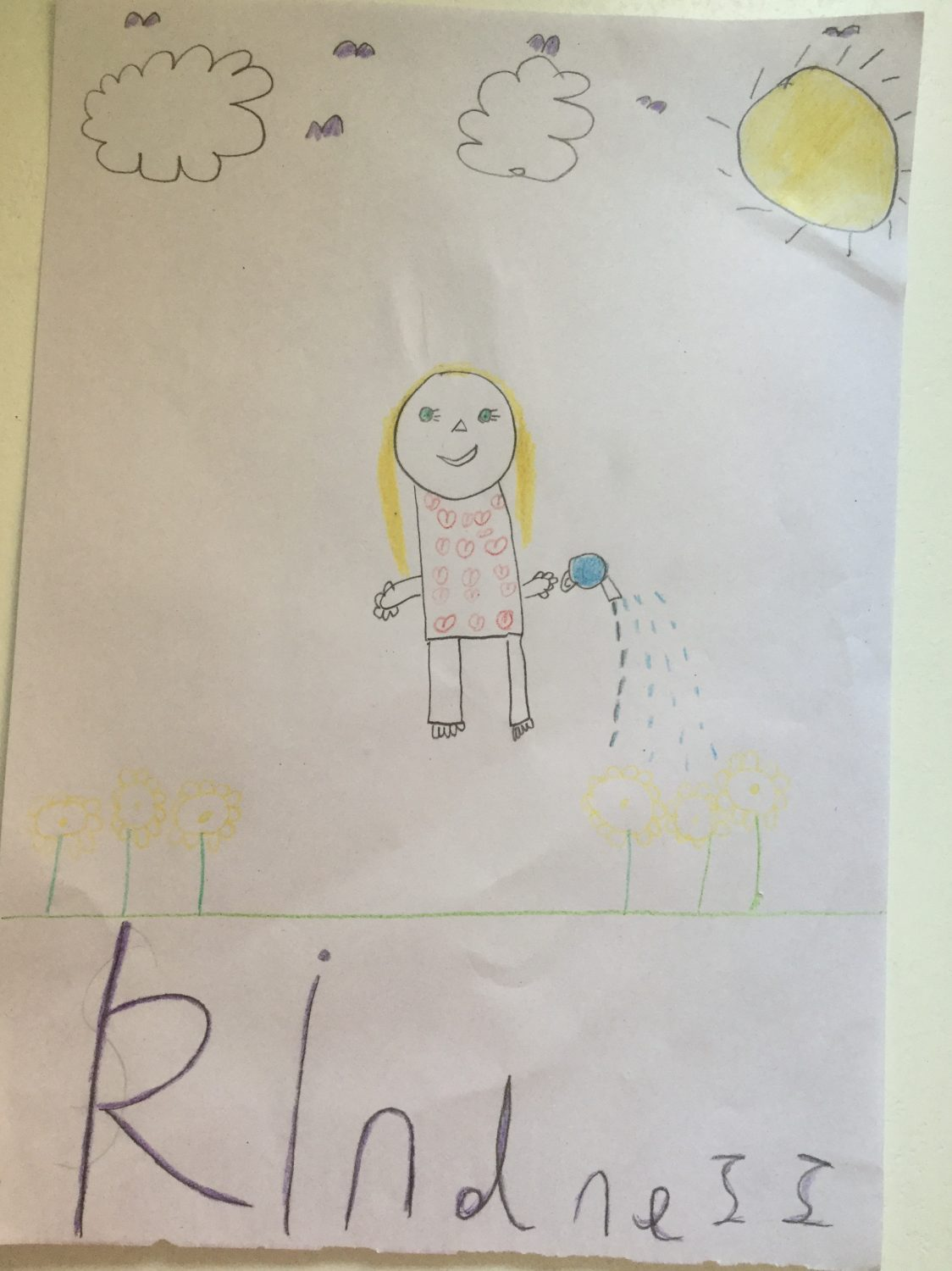 children's drawing of a girl watering yellow flowers