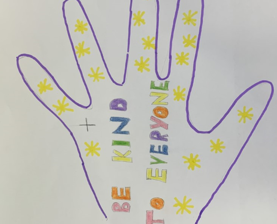 children's drawing. Outline of a hand in blue pen filled with yellow stars and the words 'Be kind to everyone'