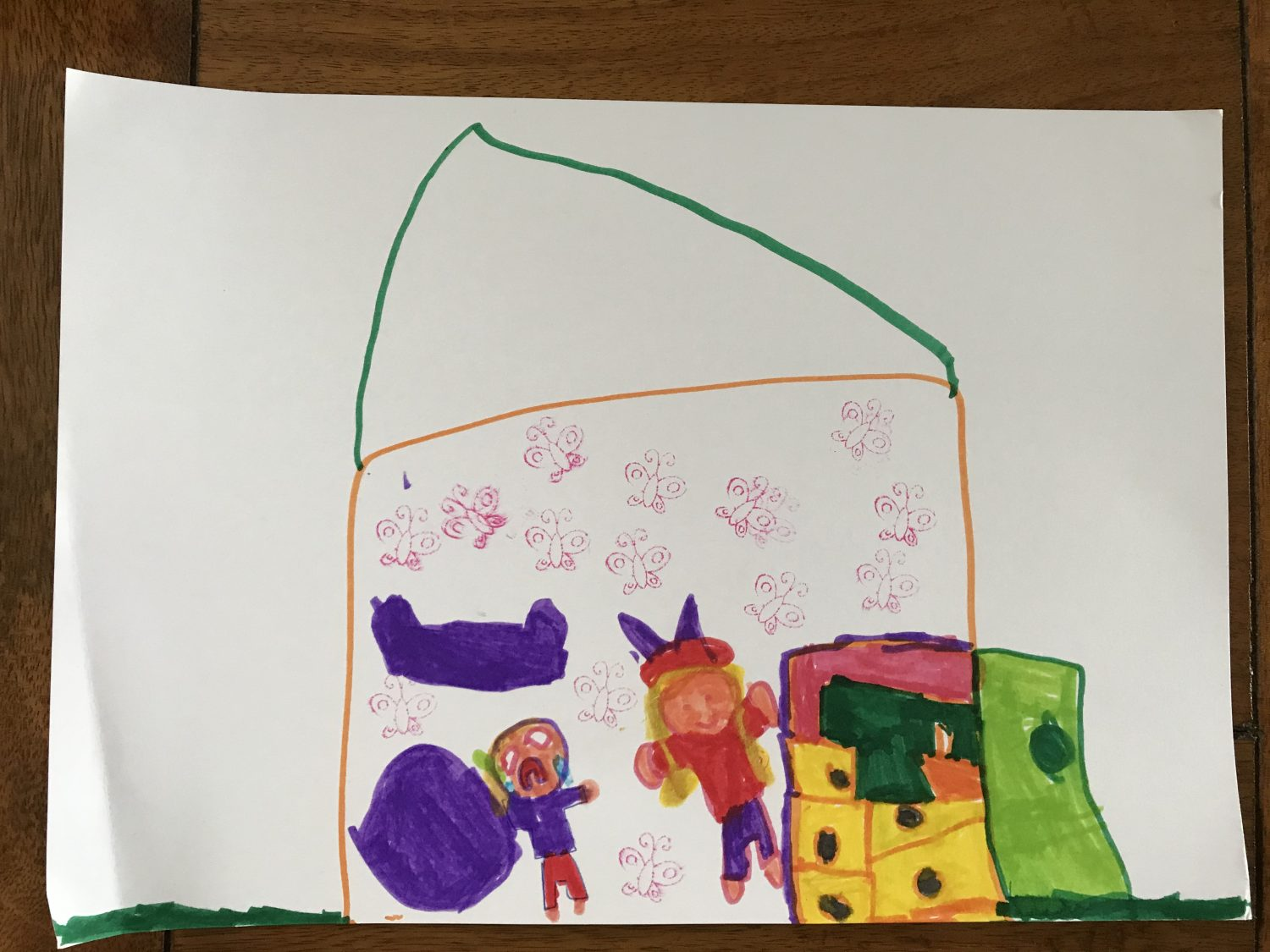 children's drawing in coloured pen of a house with two children inside
