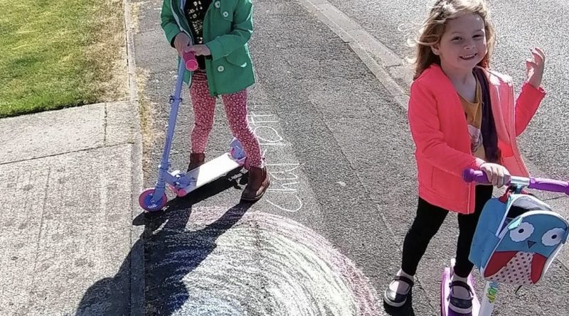 two girls on scooters