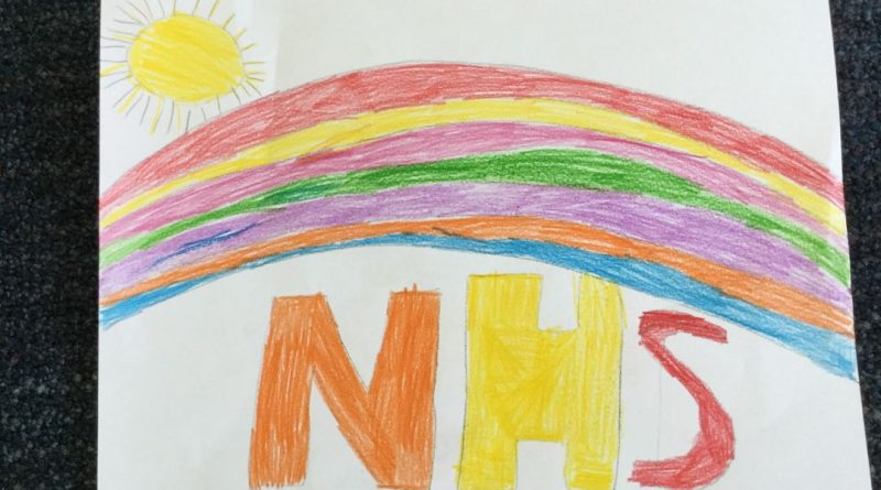 childrens drawing of a rainbow with the sun above with NHS under.