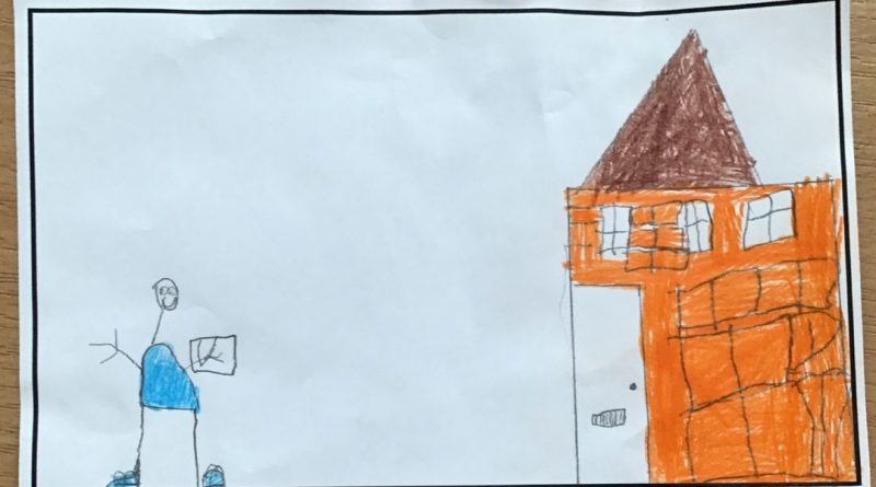 childrens drawing of a boy in-front of a building