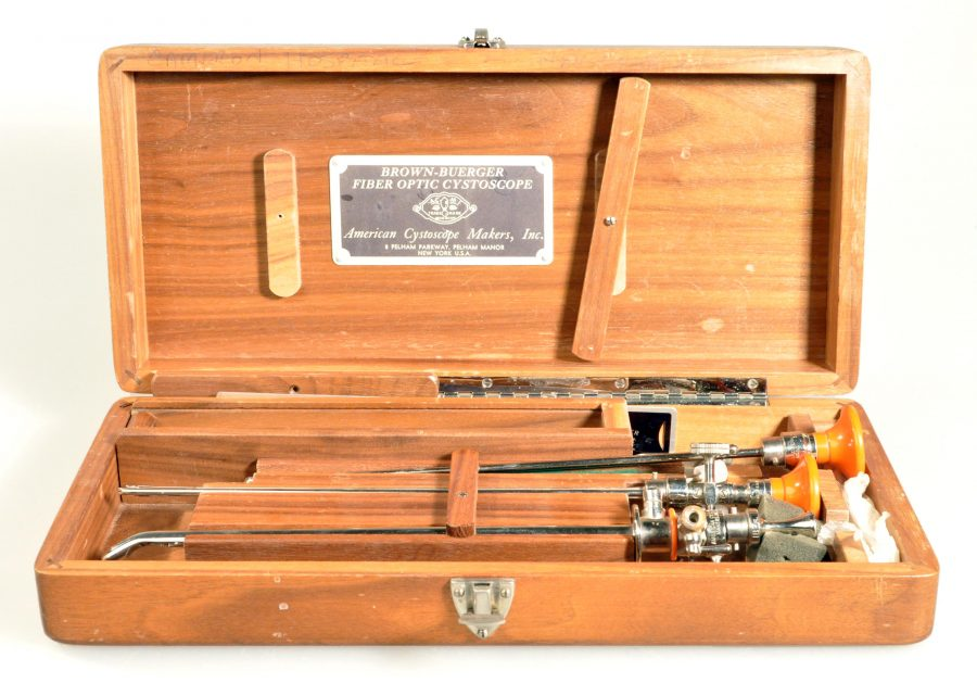open wooden box containing two silver tubes used to see inside the bladder