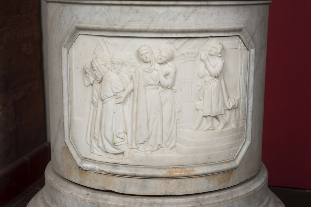 close up of the base of susannah and the elders statue