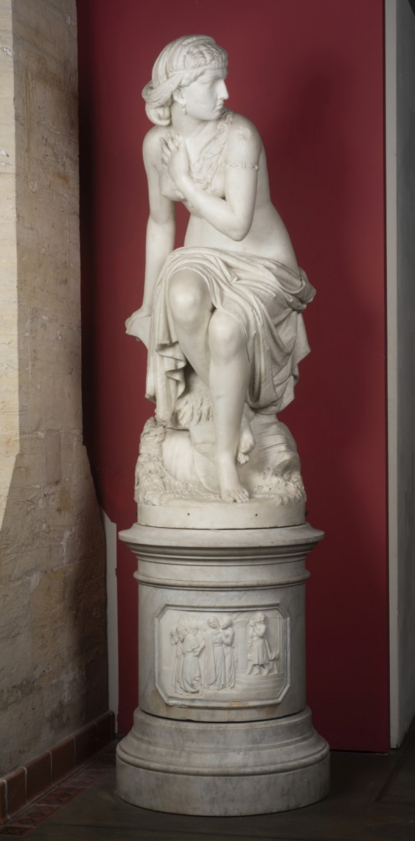 White marble statue showing the biblical story of Susannah and the Elders by Giovanni Battista Lombardi.