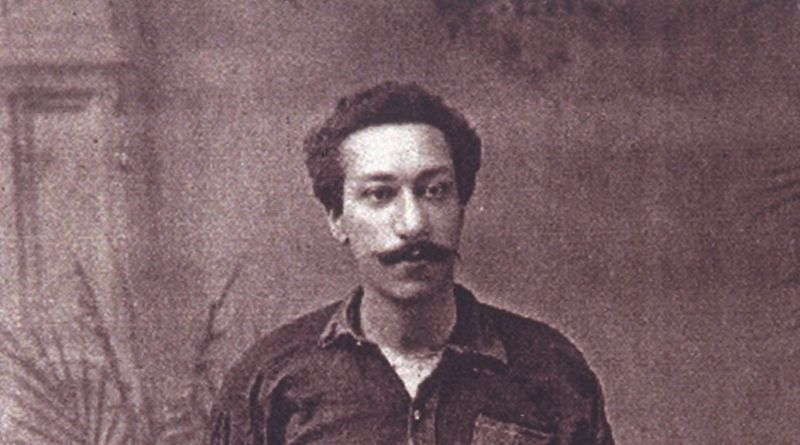 Arthur Wharton stands in his football kit. He has a long mustache with his hands resting in his pockets