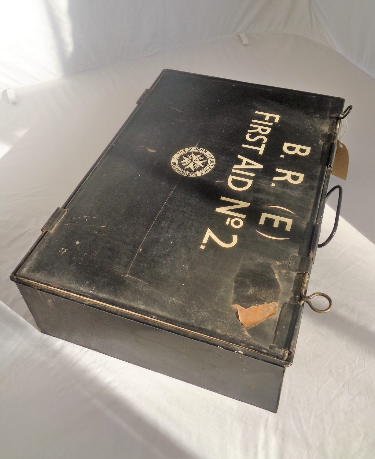 Black tin first aid box. Large with White writing on the front saying - B.R First Aid No 2