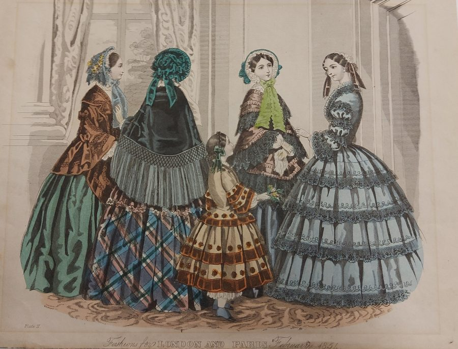 fashion plate showing four women in full dress with bonnets and shawls on a young girl, 1851