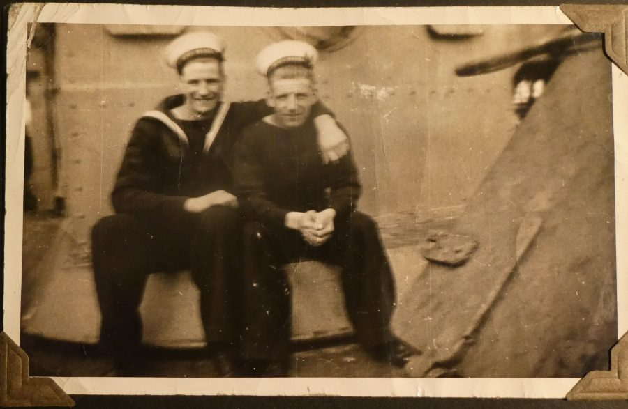 photograph of Robert William Mellanby laughing with fellow sailor onboard a ship during WW2